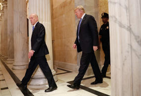 President Donald Trump, center, arrives at the U.S. Capitol in Washington, to me...