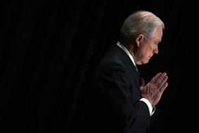 U.S. Attorney General Jeff Sessions listens as he is introduced during the Justi...