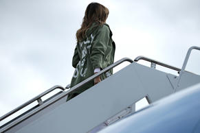 First lady Melania Trump boards a plane at Andrews Air Force Base, Md., Thursday...