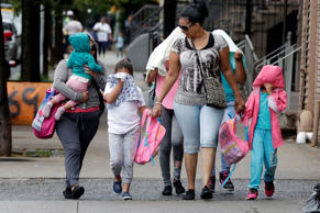 Two woman accompany children to the Cayuga Centers in New York, Thursday, June 2...