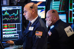 A trader works on the floor of the New York Stock Exchange on Septemeber 15, 201...