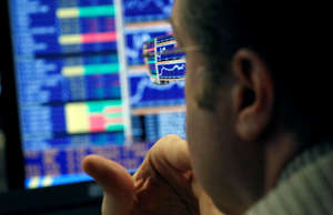 Stock broker viewing stock graphs