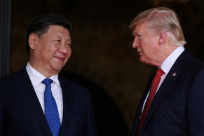 FILE PHOTO: U.S. President Donald Trump welcomes Chinese President Xi Jinping at...