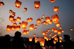 People release lanterns to celebrate the traditional Chinese Lantern Festival on...
