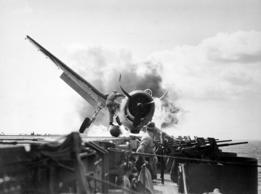 F6F Hellcat (VF-2) crash landed on USS Enterprise's flight deck. World War Two.
