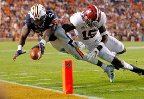 Kerryon Johnson #21 of the Auburn Tigers is hit by Ronnie Harrison #15 of the Al...