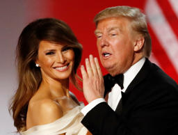 U.S. President Donald Trump and first lady Melania Trump dance while attending t...