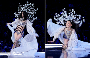 Model Ming Xi falls as she presents a creation during the 2017 Victoria's Secret...