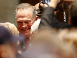 U.S. Senate candidate Roy Moore talks to the media as he prepares to vote, Tuesd...