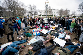 Students and supporters protest against gun violence with a lie-in outside of th...