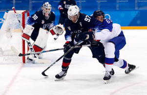 Tomas Marcinko of Slovakia in action with Matt Gilroy of the U.S. during the pla...