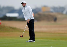 Dustin Johnson of the United States plays his shot from the first tee during rou...