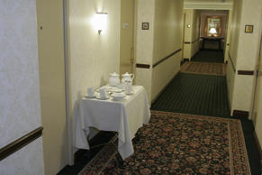 A room service rolling cart in the hallway of the Hilton Hotel. (Photo by: Jeffr...