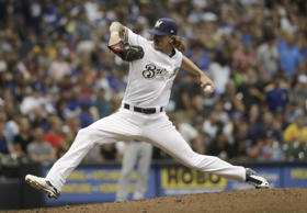 Milwaukee Brewers relief pitcher Josh Hader throws during the seventh inning of ...