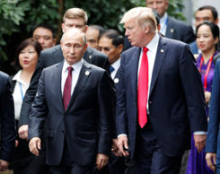 Russian President Vladimir Putin, left, and U.S. President Donald Trump during a...