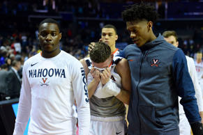 CAPTION: CHARLOTTE, NC - MARCH 16: Kyle Guy #5 of the Virginia Cavaliers exits t...