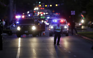 Federal investigators survey the scene near Galindo Street in Austin, Texas on M...