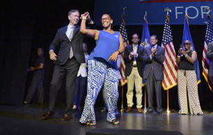 Connecticut gubernatorial candidate Ned Lamont dances with State Rep. Toni Walke...