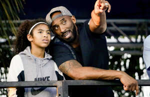 Former Los Angeles Laker Kobe Bryant and his daughter Gianna watch the U.S. nati...