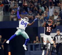 Dallas Cowboys cornerback Chidobe Awuzie (24) tips and intercepts a pass intende...