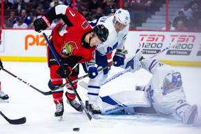 Ottawa Senators left wing Brady Tkachuk (7) battles Toronto Maple Leafs defensem...