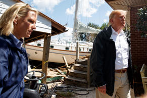 President Donald Trump visits a house where a boat wash ashore in the backyard w...