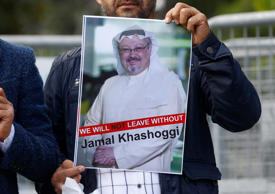A demonstrator holds picture of Saudi journalist Jamal Khashoggi during a protes...