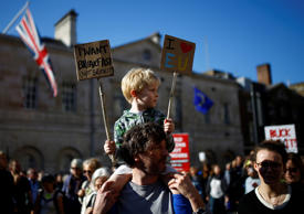 Protesters participating in an anti-Brexit demonstration march through central L...