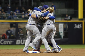 The Los Angeles Dodgers celebrate after winning Game 7 of the National League Ch...