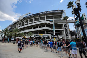 JACKSONVILLE, FL - SEPTEMBER 16: Fans wait outside the stadium prior to the game...