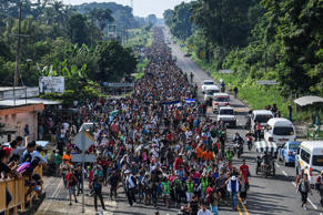 Honduran migrants take part in a caravan heading to the US on the road linking C...