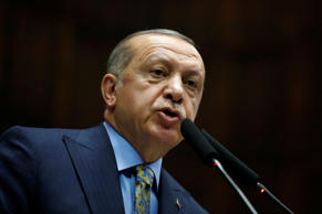 Turkish President Tayyip Erdogan addresses members of parliament from his ruling...