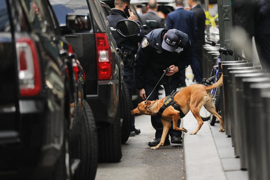 NYPD officers depart from the Time Warner Center area on Wednesday, Oct. 24, 201...
