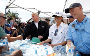 U.S. President Donald Trump, first lady Melania Trump and Florida Governor Rick ...