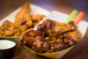 ARLINGTON, VA - NOVEMBER 28: BBQ wings (front) & Medium traditional  wings (back...