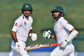 Pakistani cricketers Fakhar Zaman (L) and Azhar Ali run between the wickets duri...
