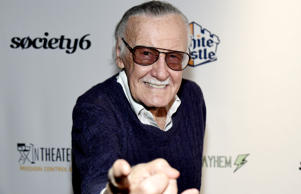 Comic book writer Stan Lee strikes a 'Spider-Man' pose.