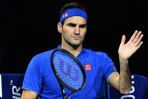 Roger Federer plays a return during his impressive win over Austria's Dominic Th...