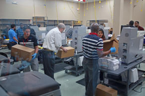 Election workers recount votes during the Florida midterm election recount on Tu...