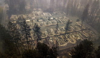 Residences were leveled by the wildfire in Paradise, Calif., on Thursday, Nov. 1...