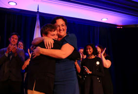 Democratic congressional candidate Katie Porter hugs her son at the end of her m...