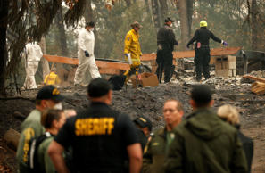 PARADISE, CA - NOVEMBER 15: A home surrounded by forest is destroyed by the Camp...