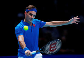 Switzerland's Roger Federer in action during his semi final match against German...