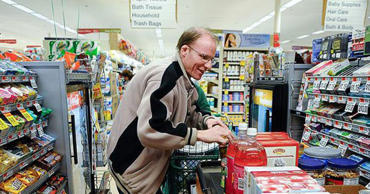 Scott Macaulay shopping for Thanksgiving groceries in 2012. (wickedlocal.com)