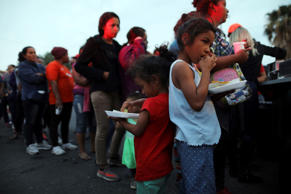 FILE PHOTO: Members of a migrant caravan from Central America and their supporte...