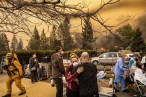 Nurse Cassie Lerossignol hugs as coworker as the Feather River Hospital burns wh...
