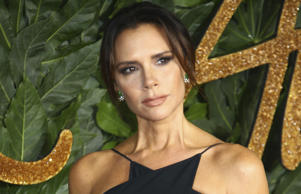 Victoria Beckham poses for photographers upon arrival at the The Fashion Awards ...