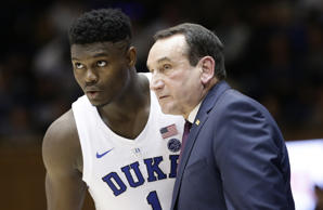Duke's Zion Williamson (1) speaks with coach Mike Krzyzewski during the first ha...