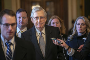Senate Majority Leader Mitch McConnell, R-Ky., leaves the chamber after speaking...