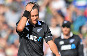 Trent Boult (L) reacts after a leg-before-wicket (LBW) appeal was turned down